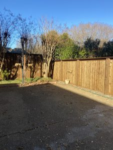wood fence around driveway in texas