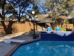 wood fence around backyard pool in dallas tx