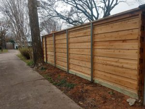 Horizontal board-on-board western red cedar wood fence