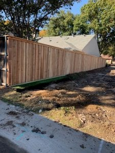 Wood Fence Being Installed