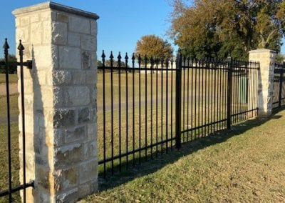 Iron Fence with Stone Columns