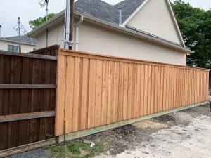 Board-on-board western red cedar wood fence, no stain