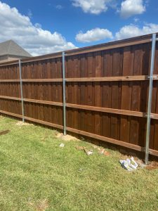 Prestained western red cedar fence with 2x4 treated rails
